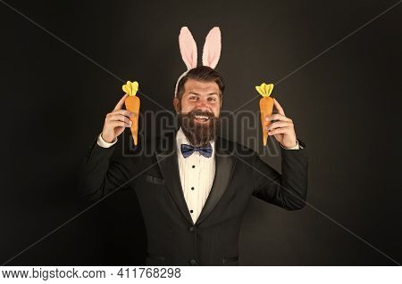 Easter Symbol. Holiday Celebration. Gentleman With Carrot. Easter Rabbit Black Background. Bearded M