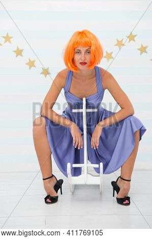 Woman Playful Cheerful Mood Having Fun. Fun And Entertainment. Back To Childhood. Girl Wig Rides Swi