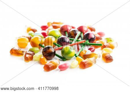 Various colorful candies. Lollipops, jelly beans and gummy bonbons isolated on white background.