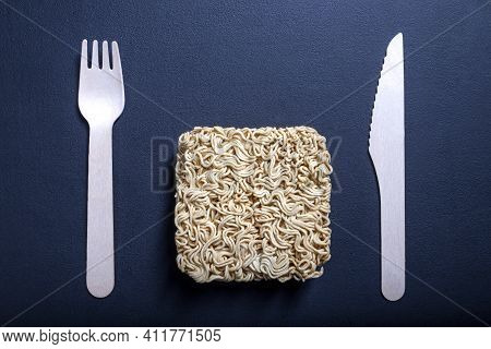 Sweetening Tea With Cane Sugar. Arranged Sugar Grains On The Table. Dark Background.