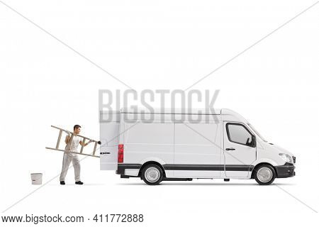 Painter decorator putting a ladder in the back of a van isolated on white background