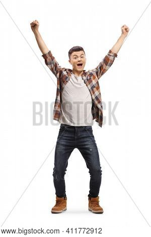 Full length portrait of an excited guy cheering with happiness isolated on white background