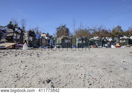 Burke County, Ga Usa - 12 27 20: Local Dump Overflowing From Christmas Trash And Waste Distant View