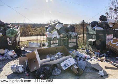 Burke County, Ga Usa - 12 27 20: Local Dump Overflowing From Christmas Trash And Waste Sun Beams