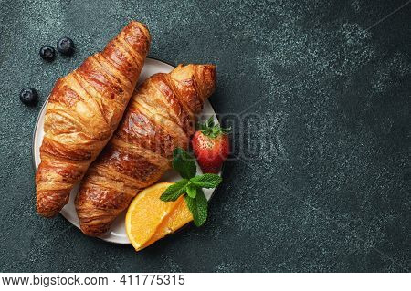 Fresh Sweet Croissants With Butter And Orange Jam For Breakfast. Continental Breakfast On A Black Co