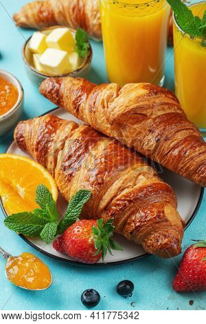 Fresh Sweet Croissants With Butter And Orange Jam For Breakfast. Continental Breakfast On A Bright C