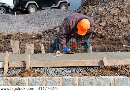 Pouring Cement During On Concrete New Sidewalk Industry Job Man