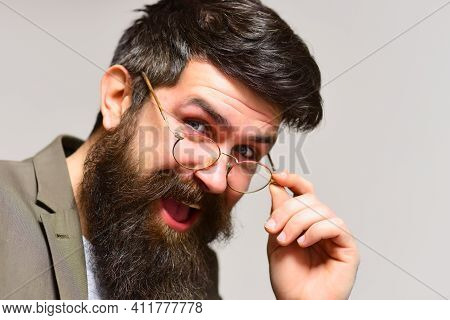 Happy Business Man With Long Beard And Mustache On Unshaven Face. Businessman Smile In Suit. Man Tea