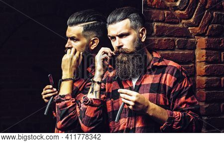 Bearded Man With Razor Near Mirror. Man With Long Beard. Handsome Man Hipster Or Guy With Beard And