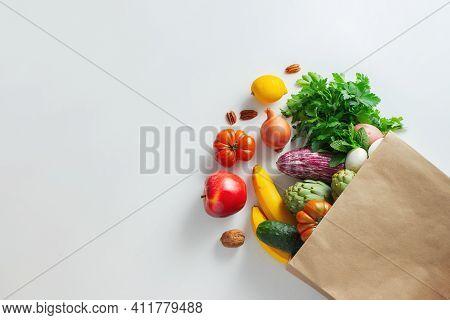 Healthy Food Background. Healthy Vegan Vegetarian Food In Paper Bag Vegetables And Fruits On White,