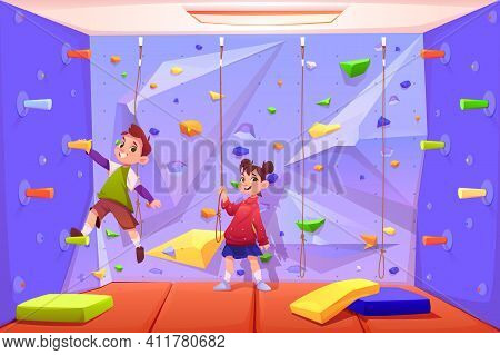 Kids Climbing Wall, Boy And Girl Playing In Recreation Area For Children Or Playing Room With Ropes