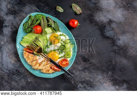 Ketogenic Breakfast. Keto Low Carb Chicken Grilled Fillet With Salad Fresh Tomatoes, Cucumbers, Eggs