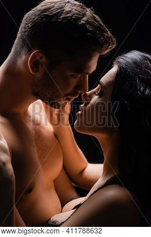 Passionate Couple Kissing With Closed Eyes Isolated On Black.