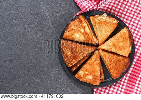 Thin Pancakes From Russian Cuisine. Russian Blini, Crepes On A Gray Background. Shrovetide Holiday.