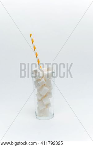 Sugar Cubes In A Glass With A Tube High-calorie Cocktail