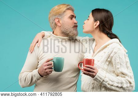 Happy Cozy Kiss Couple At Morning. Family Enjoying Usual Evening Together And Having A Romantic Mome