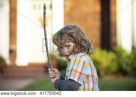 Unfriendly Angry Boy With Stick. Bullying Rage Concept. Child Aggression. Negative Kids Emotion. Ang