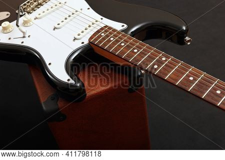 Guitar Tube Combo Amplifier With Electric Black Guitar On The Black Background.