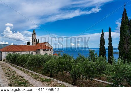 Our Lady Of The Angels Franciscan Monastery, Overlooking Orebic With The Campanile Viewed Through Th