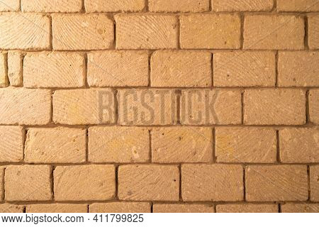 wall built of stone blocks of tuff