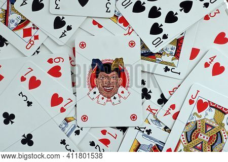 Bologna - Italy - March 9, 20201: The Jolly Joker Card On A Deck Of Playing Cards Randomly Distribut