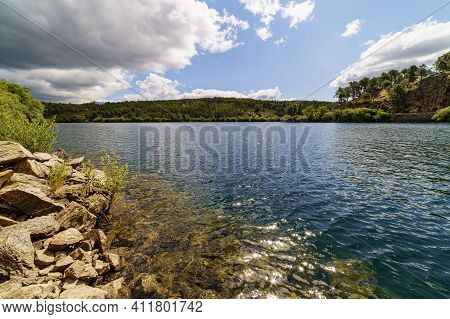 Lake With Clouds, Blue Sky And Reflections In The Water. Atazar Reservoir Madrid. Spain,