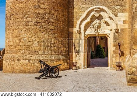Entrance To The Castle Of Belmonte With Access Door And Old Cannon Pointing To The Door. Castilla La