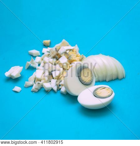 Boiled Eggs Cut Or Chopped Into Small Pieces On A Cutting Board