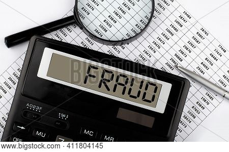 Word Fraud On Calculator. Business And Tax Concept.