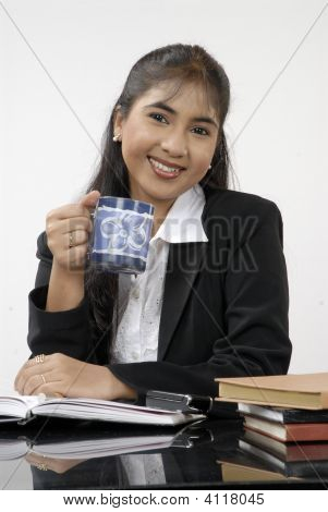 A Pretty ,Smiling Secretrary Relaxing In An Office