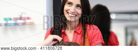 Hairdresser Stylist Holds Clients Hair In Beauty Salon. Hairdressing Service Concept.