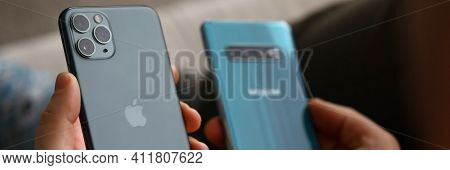 Minsk, Belarus - 30 July 2020 : Woman Hold New Model Iphone And Samsung Closeup. Illustrative Editor