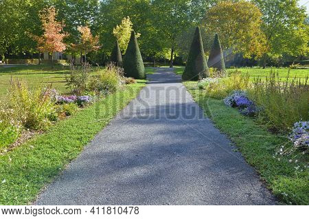 Footpath In Gravel Crossing A Beautiful Public Park Landscaped