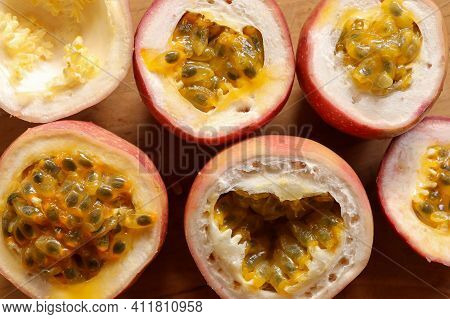 Half Cut Passion Fruit On Wooden Background. Fresh Passion Fruits-healthy Fruit And Special Taste