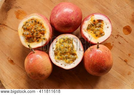 Ripe Organic Passion Fruit On Dark Background. Above View