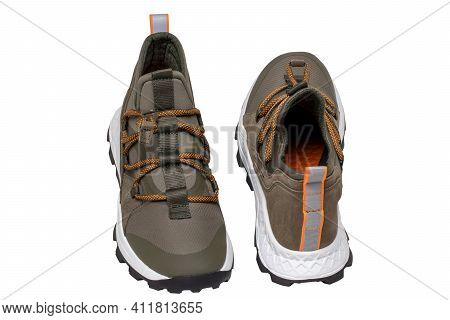 Mans Shoes Fashion. Close-up Of A Pair Of Green Sneakers Or Sport Shoes Isolated On A White Backgrou