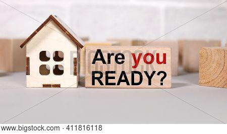 Are You Ready. Text In Black Letters On Wood Blocks. Near The House Figurine. Be Ready To Buy A Hous