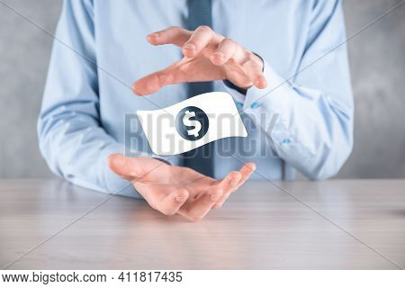 Businessman Man Holding Money Coin Icon In His Hands.growing Money Concept For Business Investment A