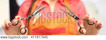 Silhouette Of Hairdresser Woman Holding Scissors In Foreground. Tools For Hairdressers Concept