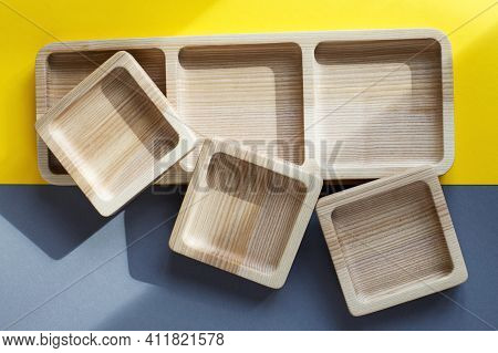Wood Empty Plates For Snack On Color Grey And Yellow Background