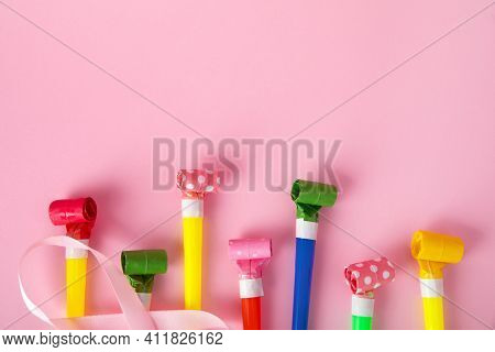 Birthday Party Whistles On Pink Background, Colorful Celebration With Party Blower Horns, Minimal Pa