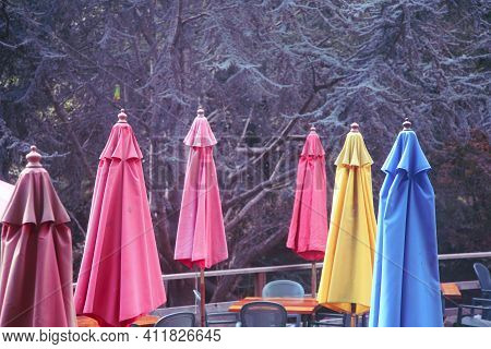 Colorful Parasol On The Terrace Of A Restaurant