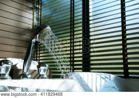 Soft Focused Of Movements Of Water Out From Shower In Jacuzzi Pool With Background Of Wooden Blinds