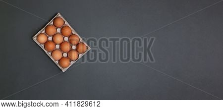 Horizontal Banner With Eggs In Egg Carton On Gray Background.