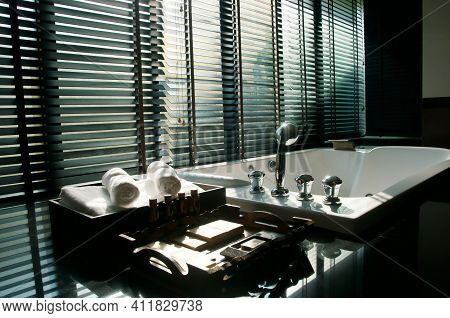 Window Blinds With Light And Shadow On The Granite Floor And Warm Lighting In Spa Resort, Close Up O