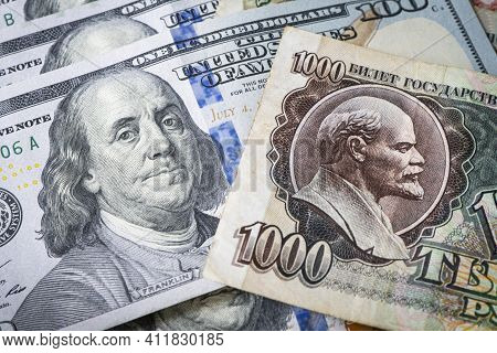 The Russian Soviet Ruble And 100 Of American Dollars. Confrontation Between The Capitalist And Socia