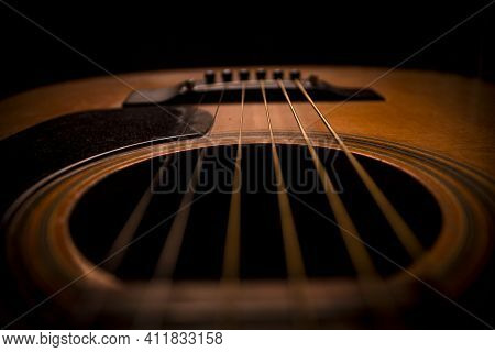 Guitar.guitar's Chords.acoustic Guitar.music.music Background.image Of An Acoustic Guitar In The Dar