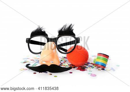 Clown Nose, Funny Glasses And Party Blower On White Background