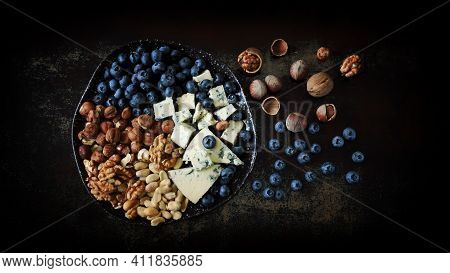 A Plate With Cheese, Nuts And Blueberries. Healthy Snack. Cheese Plate. Keto Snack. Keto Dessert.