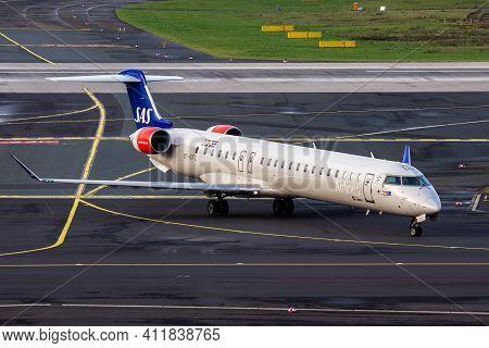 Sas Scandinavian Airlines Bombardier Crj-900lr Passenger Plane Arriving At Dusseldorf Airport. Germa